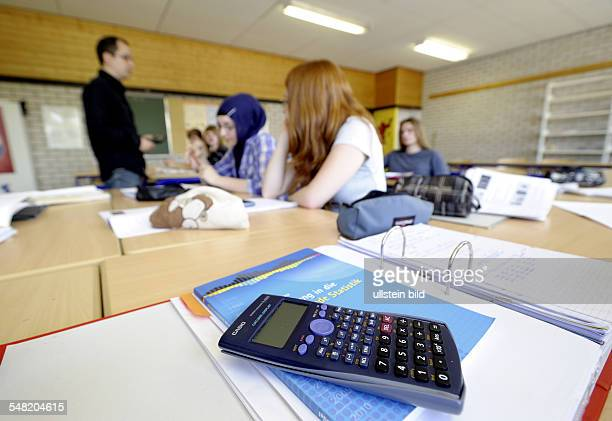 Germany RhinelandPalatinate A teacher teaching mathematics in a High School / Gymnasium in the foreground a calculator