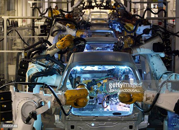 Robots assemble Volkswagen Golf models on an automated production line at VW's headquarters and main manufacturing plant in Wolfsburg 21 September...