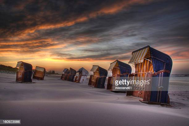 Germany, Roofed wicker beach chairs at Baltic Sea