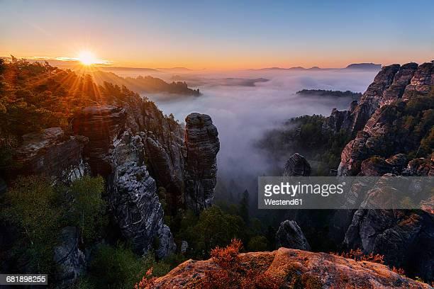 Germany, Saxon Switzerland National Park, Bastei, Hoellenhund at Raaber Kessel at sunrise
