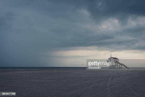 Germany, Schleswig-Holstein, St Peter-Ording, stilt house at beach, stormy atmosphere