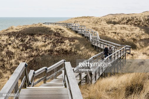 Germany, Schleswig-Holstein, Sylt, Wooden boardwalk through dunes