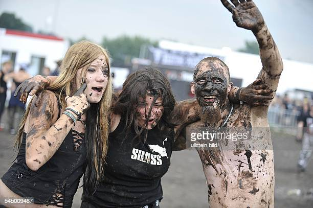 Germany SchleswigHolstein Wacken Wacken Open Air 2008 People with dirty faces