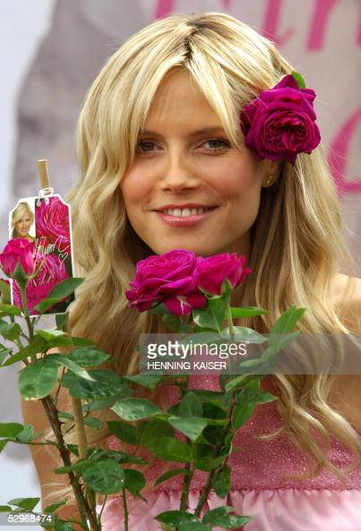 heidi klum poses with heidi klum rose photos and images getty images. Black Bedroom Furniture Sets. Home Design Ideas