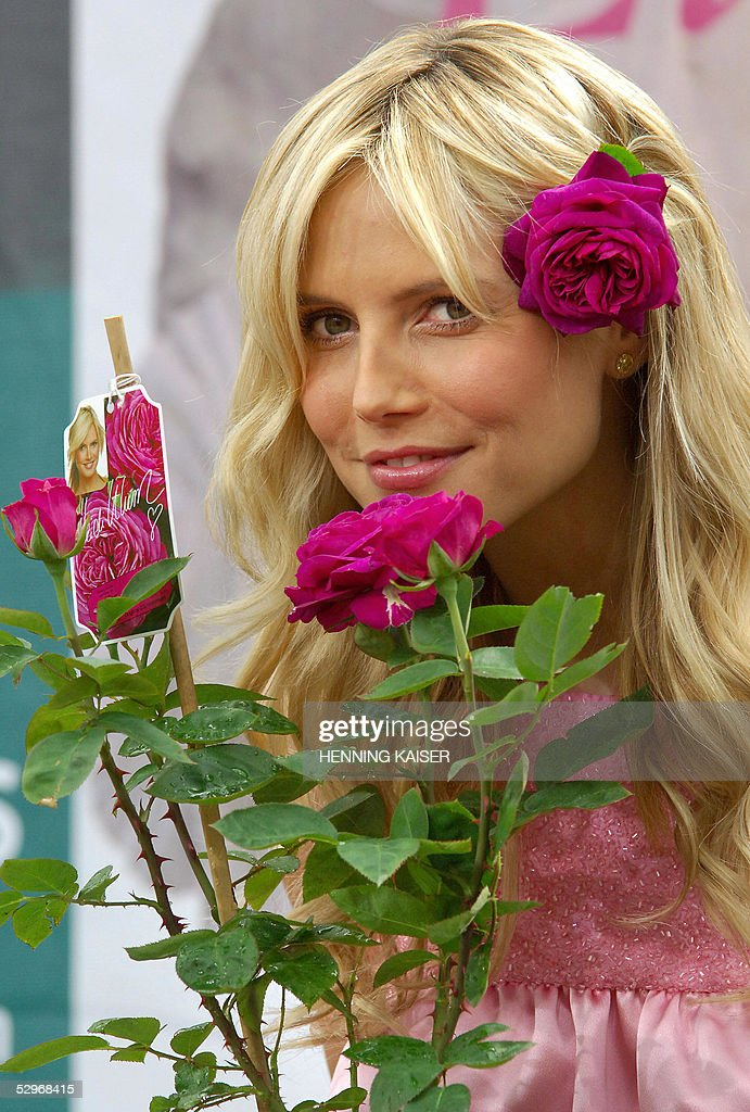 heidi klum poses with heidi klum rose getty images. Black Bedroom Furniture Sets. Home Design Ideas