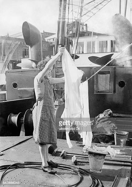 Germany ship transport on the Rhine woman hanging out laundry on deck date unknown probably 1937 published in Bazar 6/1937 photo by H E Reeck