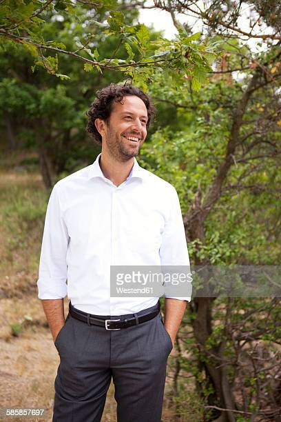 Germany, smiling businessman in forest