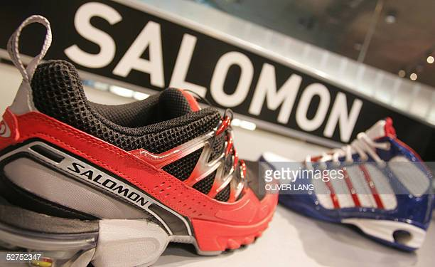 Sport shoes of the brands Adidas and Salomon are seen in a shop 03 May 2005 in Herzogenaurach southern Germany AdidasSalomon the German maker of...