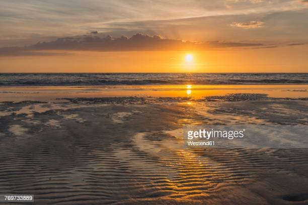 Germany, St Peter-Ording, sunset above the sea