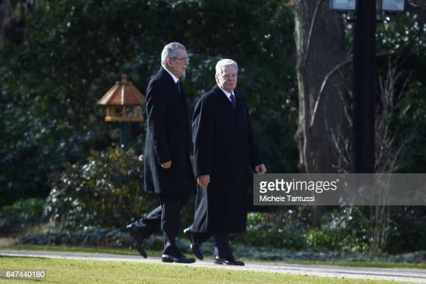 Germany state President Joachim Gauck and Austrian's state President Alexander Van der Bellen walk in the park of the Bellevue Castle ahead of the...
