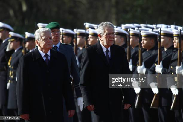 Germany state President Joachim Gauck and Austrian's state President Alexander Van der Bellen walk in the park of the Bellevue Castle during of the...