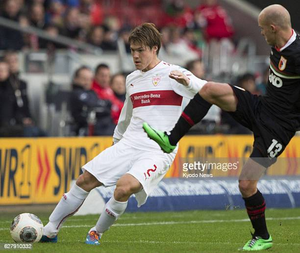 STUTTGART Germany Stuttgart defender Gotoku Sakai of Japan keeps the ball while being challenged by Augsburg's Tobias Werner in the first half of a...