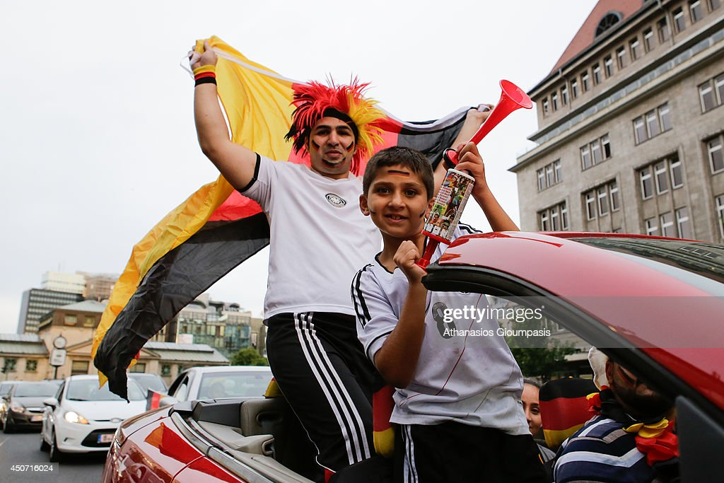 Germany supporters celebrete at Kurfuerstendamm street the win of German National team 4-0 at the 2014 FIFA World match between Germany and the Portugal on June 16, 2014 in Berlin, Germany.