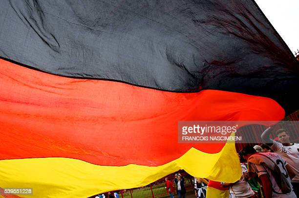 Germany supporters hold a German flag on June 12 2016 on General De Gaulle square in Lille northern France during the 'fan walk' heading to the...