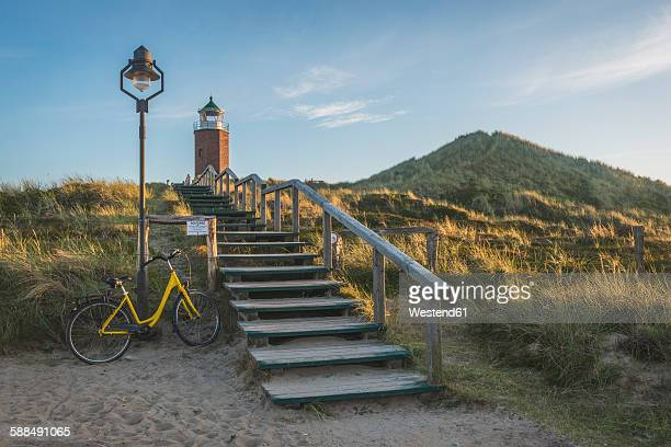 Germany, Sylt, Kampen, stairs to cross light and parked bicycle leaning at lantern