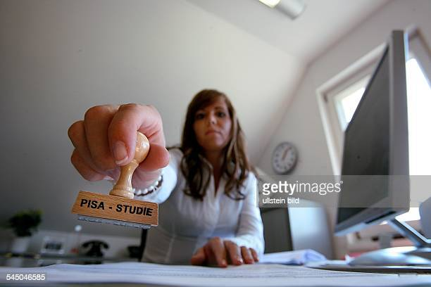 symbolic photo education school woman at the desk in the office stamp that read 'PISA study'