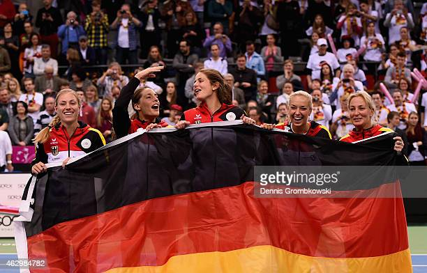 Germany team Angelique Kerber Andrea Petkovic Julia Goerges Sabine Lisicki and captain Barbara Rittner celebrate after their victory in the Fed Cup...