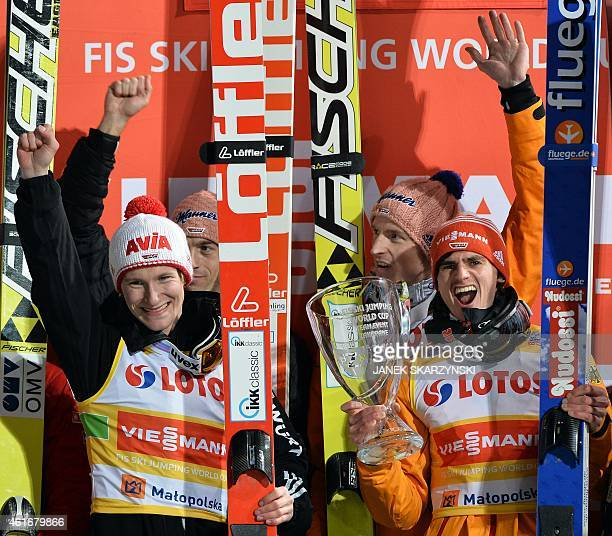 Germany team Richard Freitag Michael Neumayer Severin Freud and Marinus Kraus celebrate on the podium after winning the team competition of the FIS...
