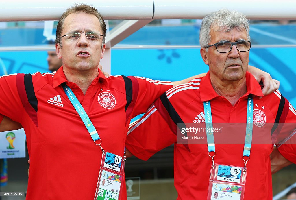 Germany team staff members <a gi-track='captionPersonalityLinkClicked' href=/galleries/search?phrase=Tim+Meyer&family=editorial&specificpeople=623213 ng-click='$event.stopPropagation()'>Tim Meyer</a> (L) and Josef Schmitt look on during the 2014 FIFA World Cup Brazil Group G match between Germany and Portugal at Arena Fonte Nova on June 16, 2014 in Salvador, Brazil.