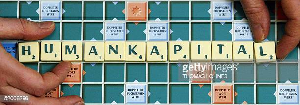 The German word 'Humankapital' is written with the letters of a Scrabble game 18 January 2005 in Frankfurt/Main A German panel of linguists and...