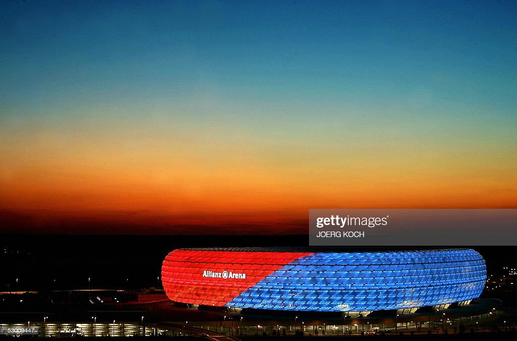The new Allianz Arena Football stadium is seen as the sun sets 25 May 2005 in Munich during a lighting test The stadium has been inaugurated with two...
