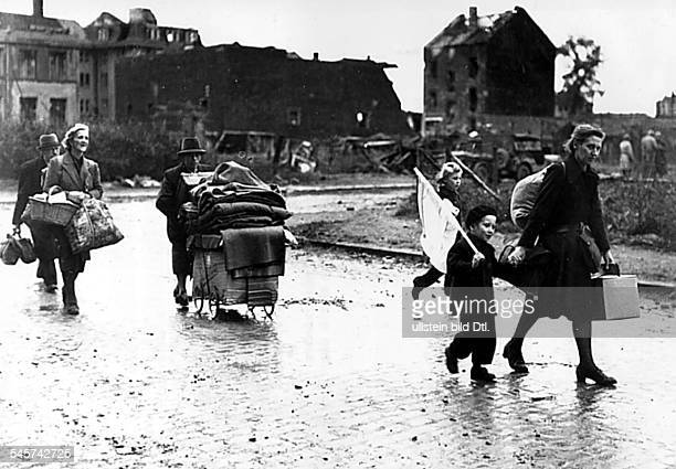 2WW Germany theater of war The civilian population which had fled during the battles returns after allied troops have occupied the city Aachen...