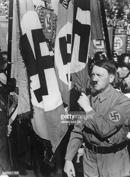 Germany Third Reich NSDAP Nuremberg Rally 1936 Adolf Hitler consecrating new standards of the NSDriver's Corps with the Nazi ceremonial flag during...