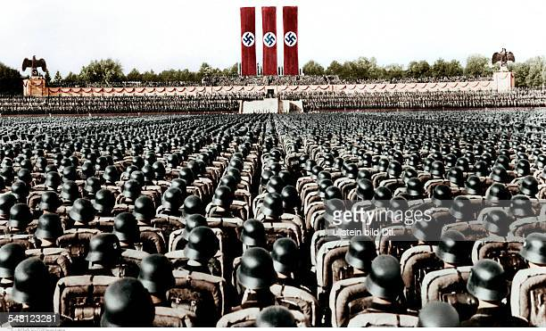 Germany Third Reich NSDAP Nuremberg Rally 1936 Parade of the NSDriver's Corps the SA and the SS at the rally ground digitally colorized Original...