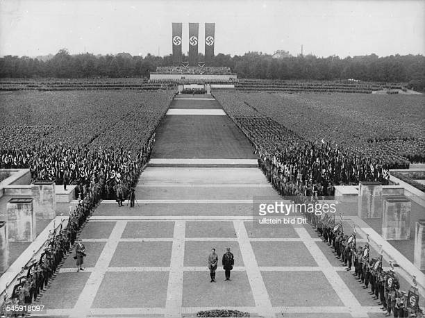 Germany Third Reich Nuremberg Rally 1933 Adolf Hitler and Ernst Roehm commemorating those who fell for the movement during a mass rally of the SS and...