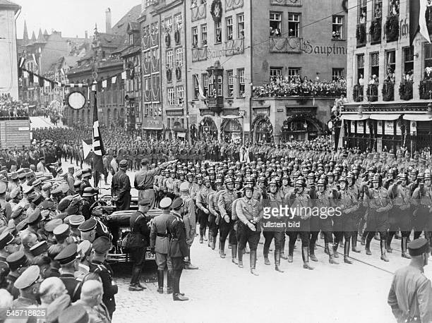 Germany Third Reich Nuremberg Rally 1933 Parade of the National Socialist Driver's Corps in Nuremberg| standing in the car Adolf Hitler and Ernst...
