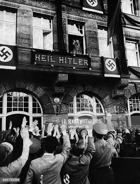 Germany Third Reich Nuremberg Rally 1934 Adolf Hitler greeting cheering crowds from a balcony autumn 1934