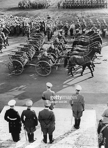 Germany Third Reich Nuremberg Rally 1935 'Defense Force Day' at the rally ground| marchpast of a cavalry machine gun unit before Hitler and other...