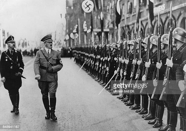 Germany Third Reich Nuremberg Rally 1935 Hitler and the head of the SS Heinrich Himmler walking past a guard of honour of the `Leibstandarte Adolf...