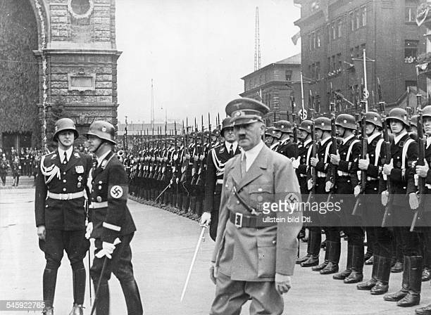 Germany Third Reich Nuremberg Rally 1938 Adolf Hitler standing before an SS guard of honour after his arrival at the train station in Nuremberg 2nd...
