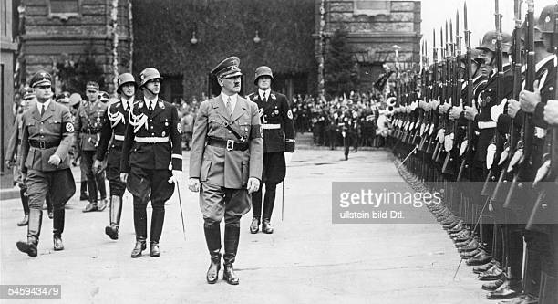 Germany Third Reich Nuremberg Rally 1938 Adolf Hitler taking the salute of an SS guard of honour after his arrival at the train station in Nuremberg...