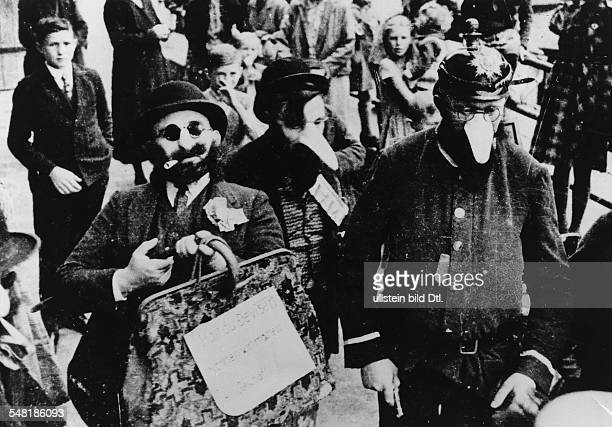 Germany Third Reich persecution of Jews 193339 propaganda Nazi ideology influencing a local folk custom in the town of Leissling locals performing...