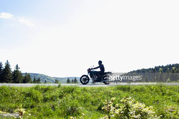Germany, Thuringia, Suhl, Motorbike on country road