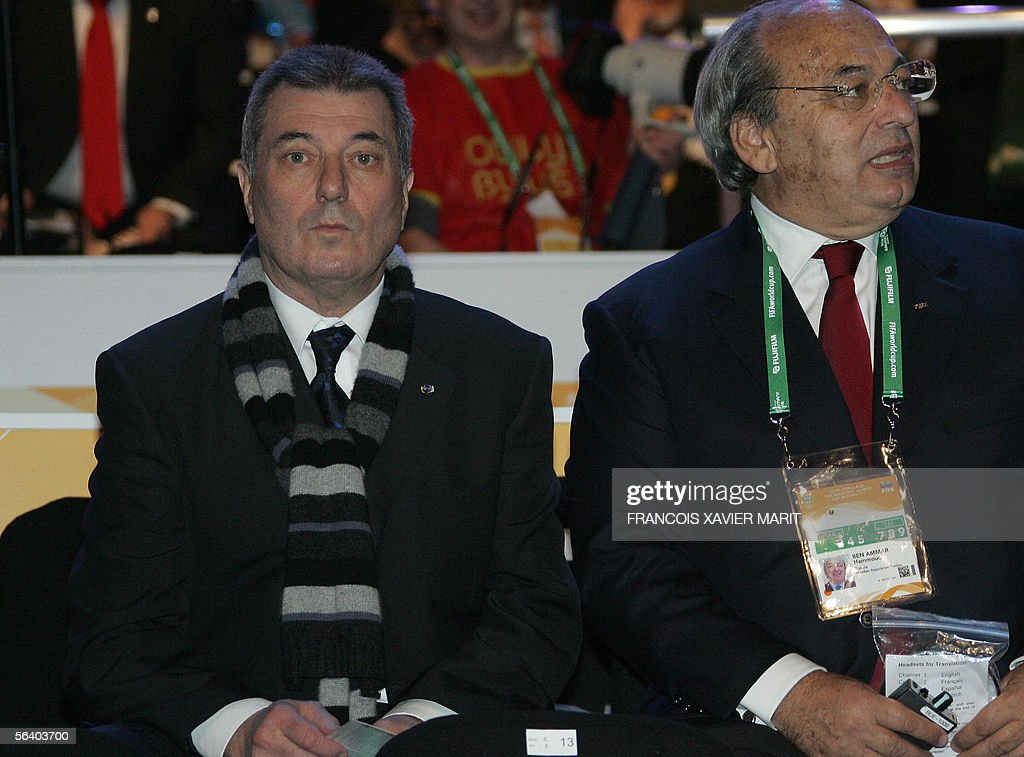Tunisia?s French head coach Roger Lemerre (L) is seen during the final draw of the Fifa World Cup 2006 in Leipzig 09 December 2005. World Cup holders Brazil and the other 31 nations competing in next year's finals learned their first-round opponents when the draw was made in a star-studded ceremony.