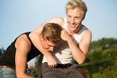 Germany, two friends having fun with a basketball