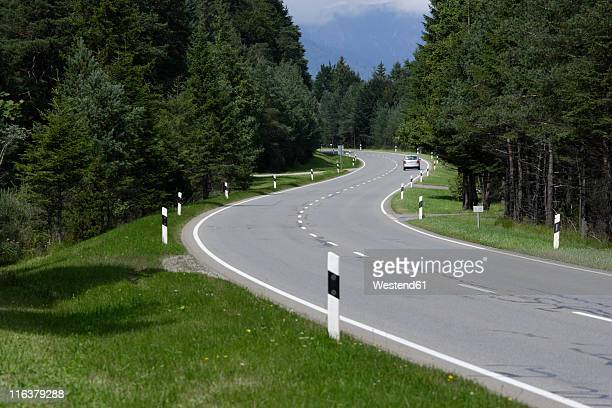Germany, Upper Bavaria, Mittenwald, View of car moving through road