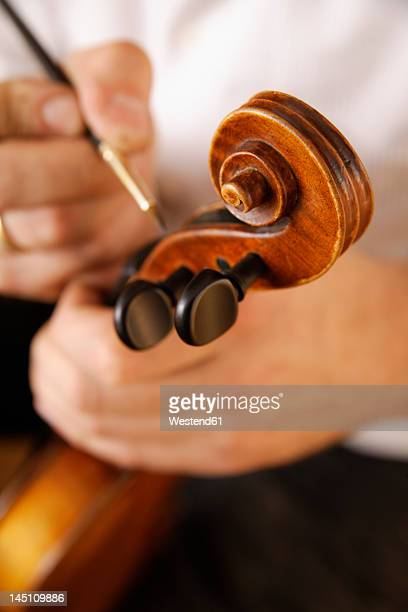 Germany, Upper Bavaria, Schaeftlarn, Violin maker making violin, close up