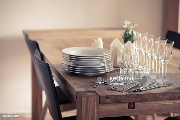 Germany, Vaihingen, Dishes and glasses on table
