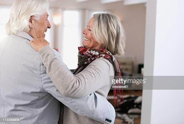 Germany, Wakendorf, Senior couple dancing, smiling