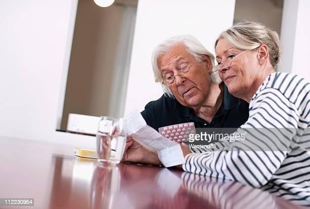 Germany, Wakendorf, Senior couple with medicine