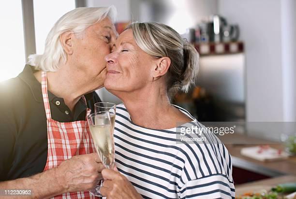 Germany, Wakendorf, Senior man kissing woman, close up