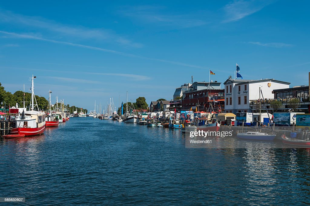 Germany, Warnemuende, Old Channel, Warnow river and fishing boats