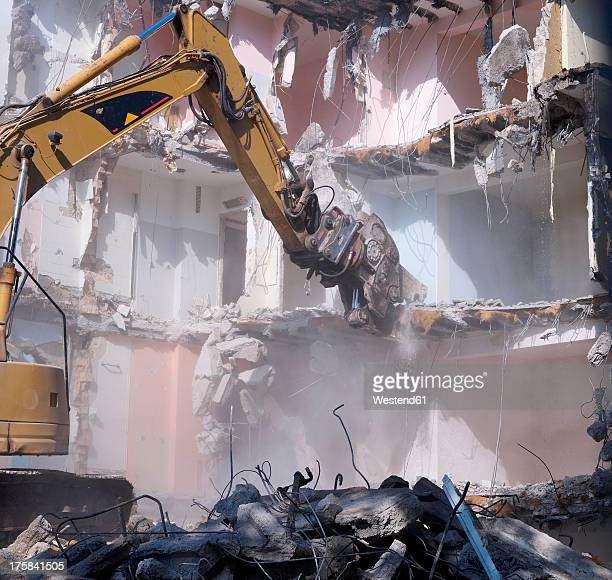 Germany, Wiesbaden, View of demolishing house with hydraulic cutter crane