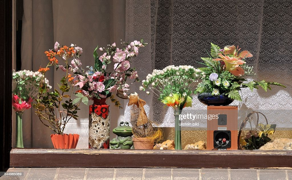 window decoration with plastic flowers and knickknack
