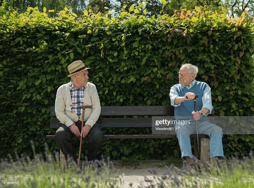 Germany, Worms, Two old friends sitting on bench in park