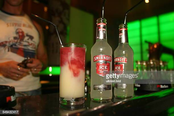 Young persons at nightlife Alcoholic mixed drinks Smirnoff Ice